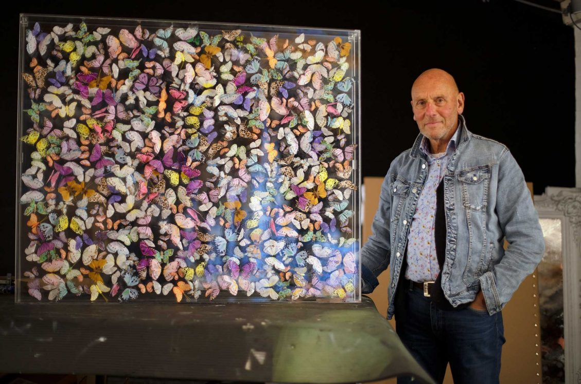 Michael Olsen standing next to his Butterfly Art